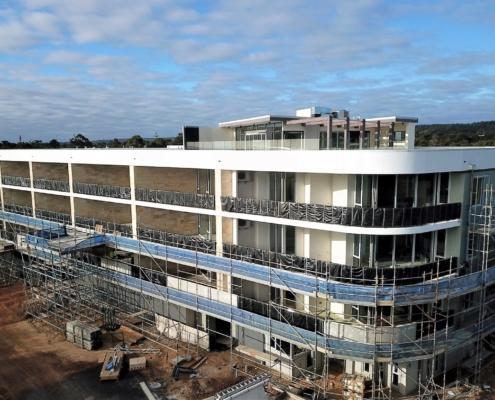 New apartment building under construction showing wrap around verandahs